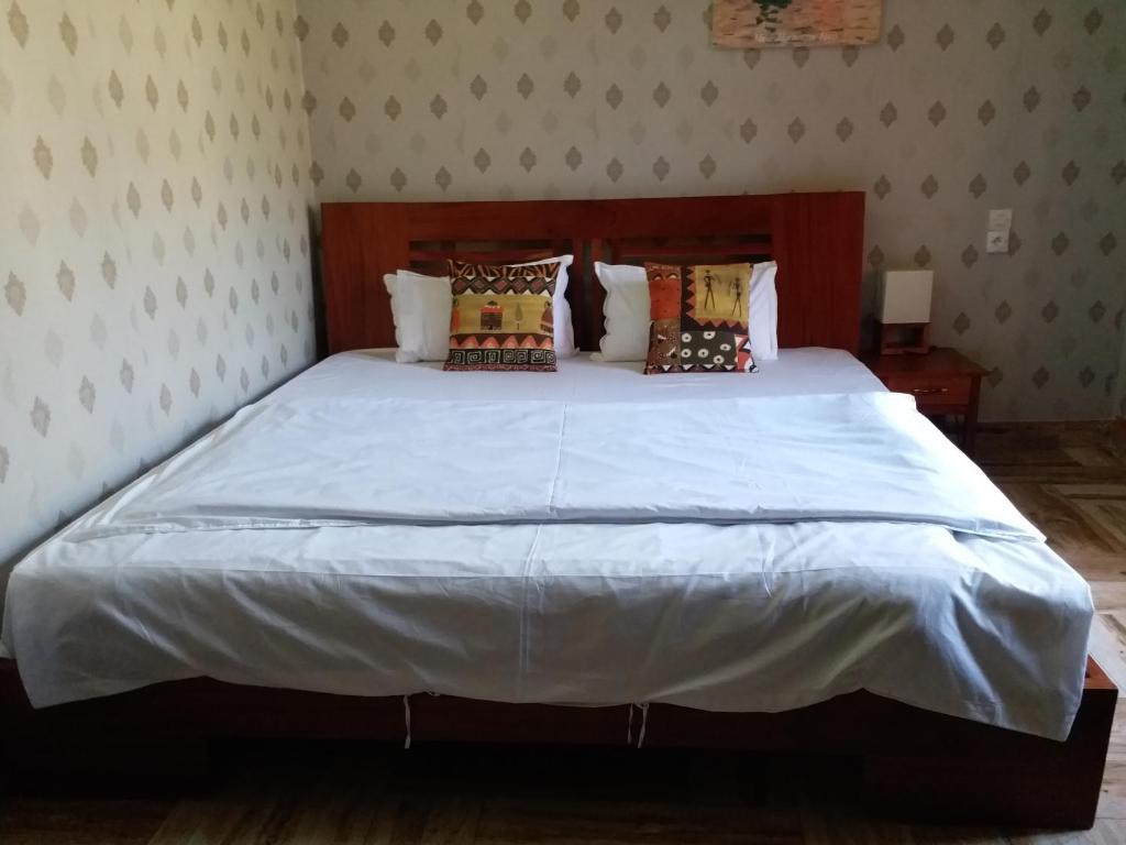 Un ou plusieurs lits dans un hébergement de l'établissement Residence Hoteliere Olympus