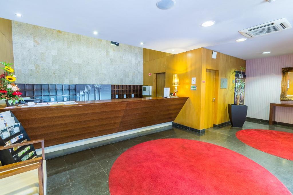 El vestíbulo o zona de recepción de Eurosol Residence