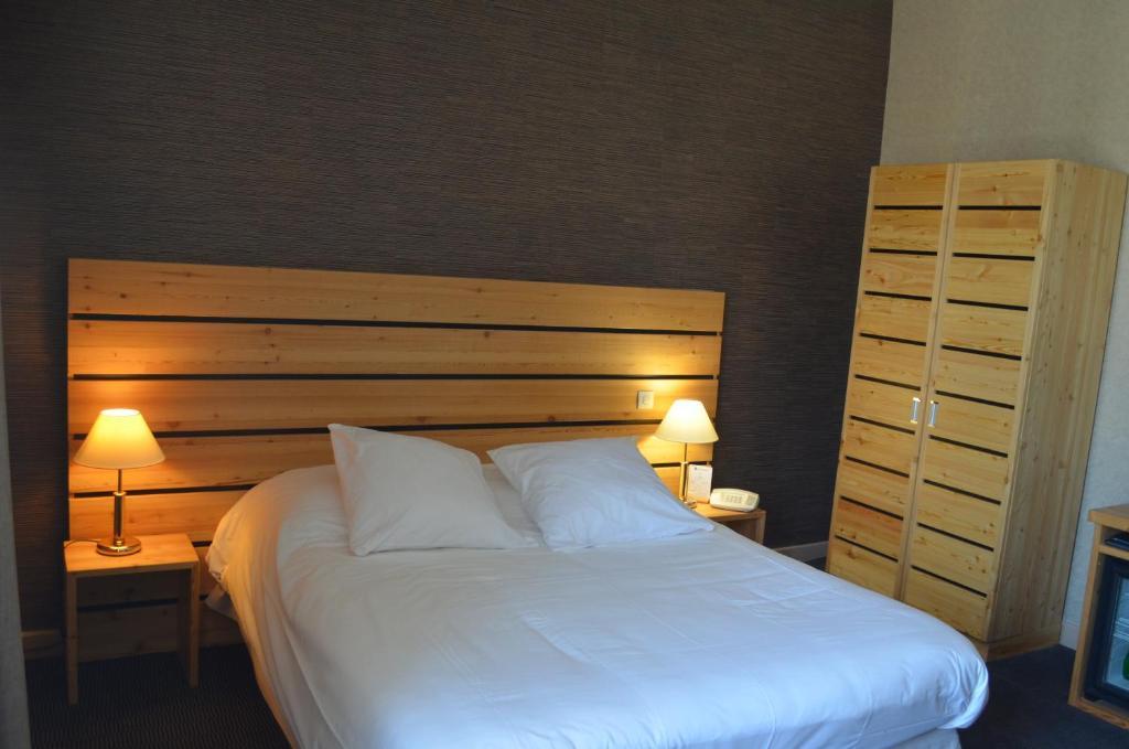 Un ou plusieurs lits dans un hébergement de l'établissement Hôtel Terminus
