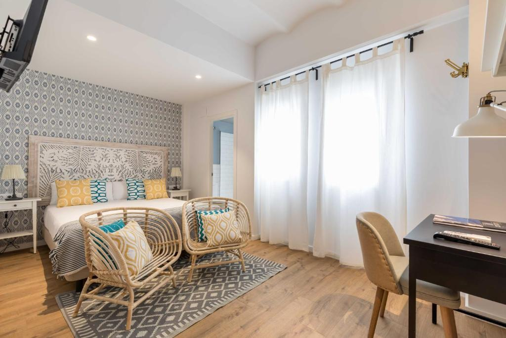 A bed or beds in a room at Maison Reina
