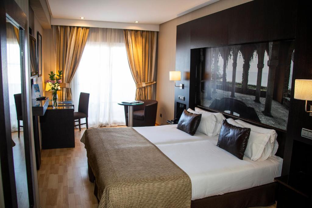 Cama o camas de una habitación en Ulises Hotel