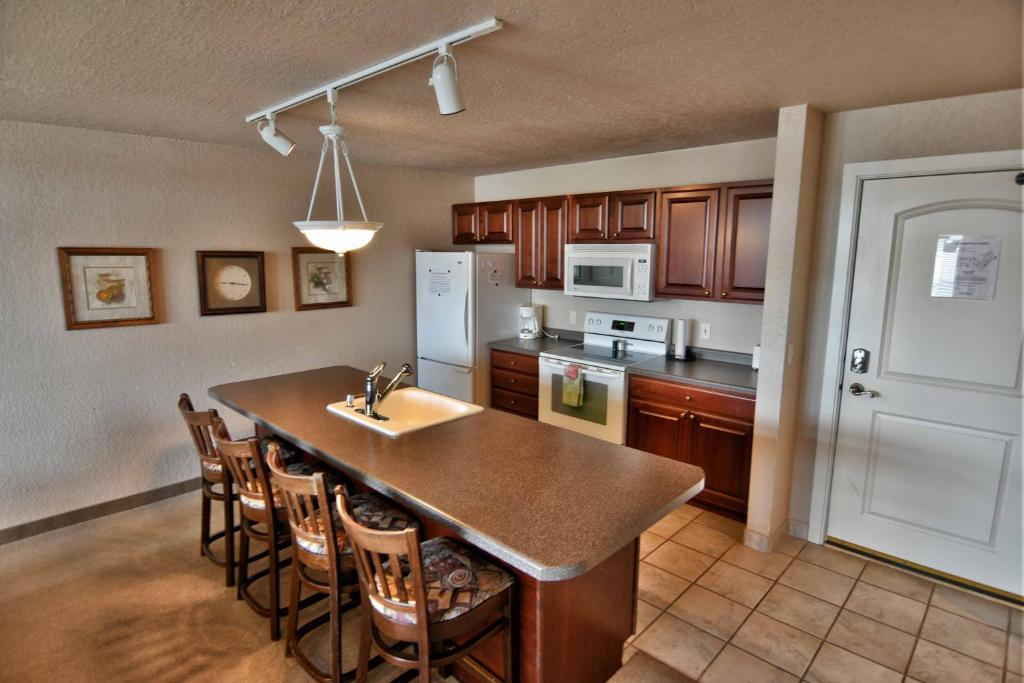 A kitchen or kitchenette at Unit 303 Two-Bedroom Condo