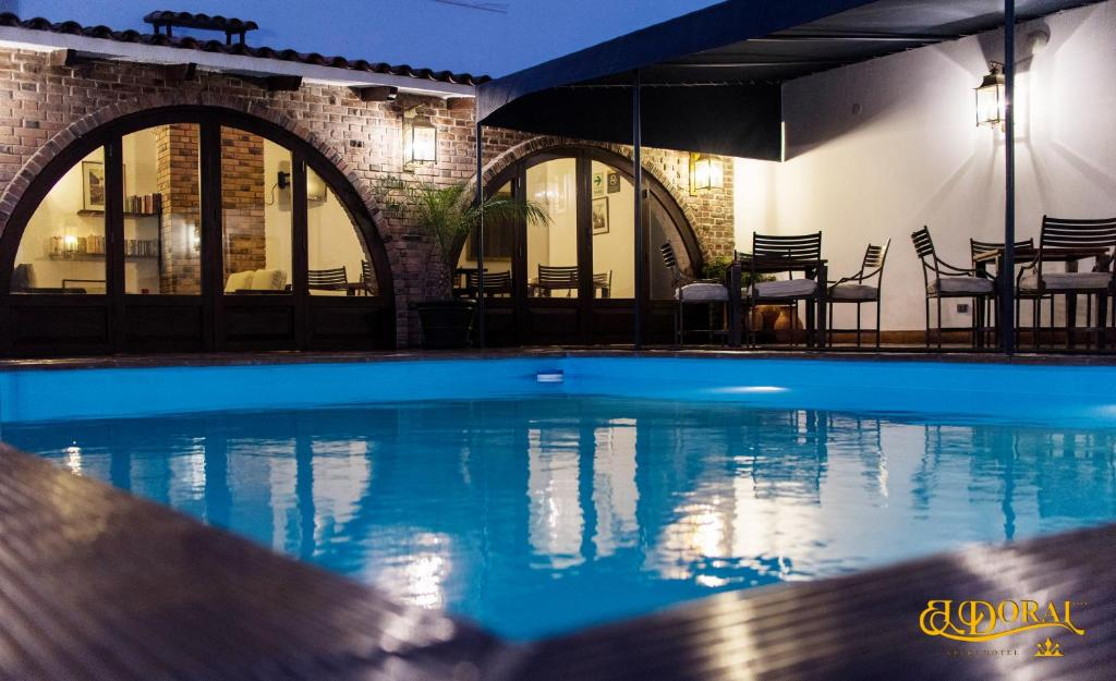 The swimming pool at or close to Apart Hotel El Doral