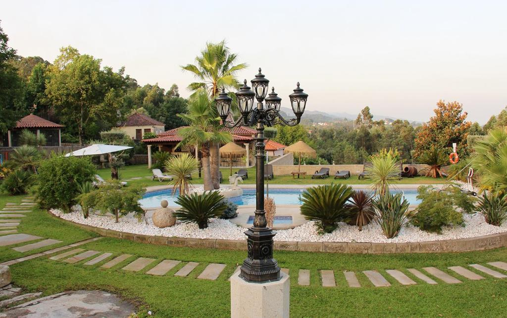 The swimming pool at or near Casas do Picoutinho