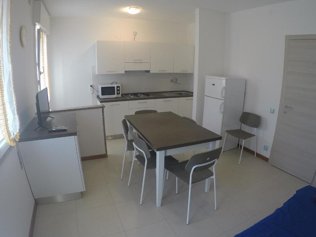 Kuchyň nebo kuchyňský kout v ubytování Appartamento Tintoretto