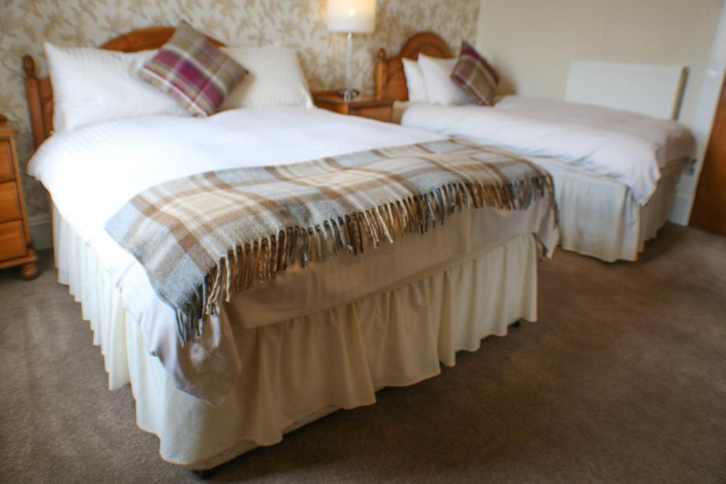 A bed or beds in a room at Station Hotel Stonehaven