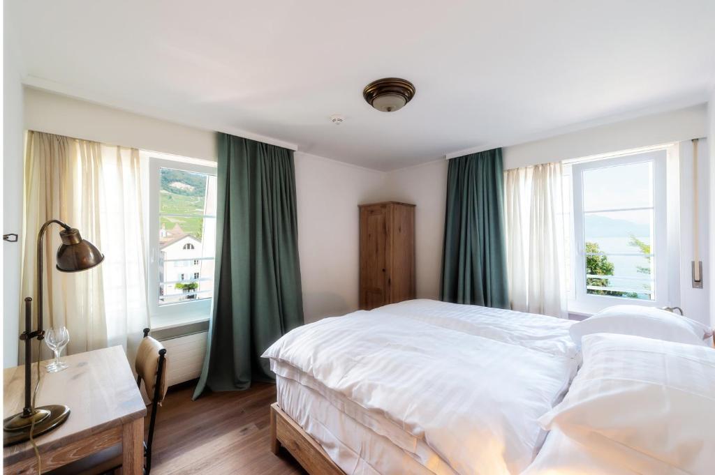 Un ou plusieurs lits dans un hébergement de l'établissement Au Major Davel