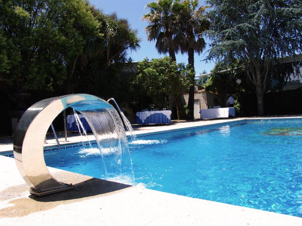 The swimming pool at or near Hotel Sena