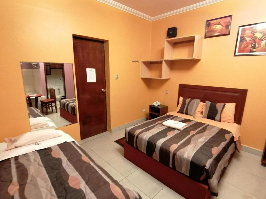Cama o camas de una habitación en Hostal GQ