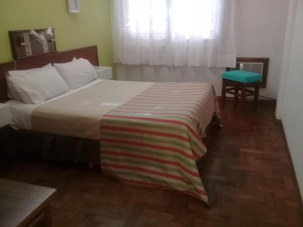 Una cama o camas en una habitación de Hotel Alfil Express