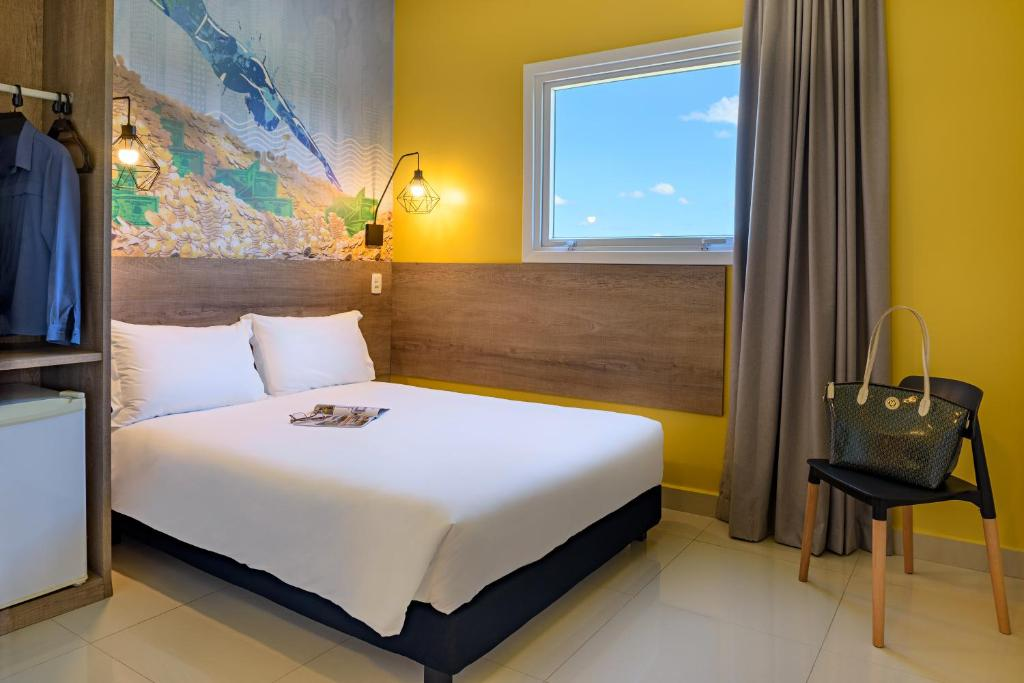 A bed or beds in a room at ibis Styles Sao Jose do Rio Preto