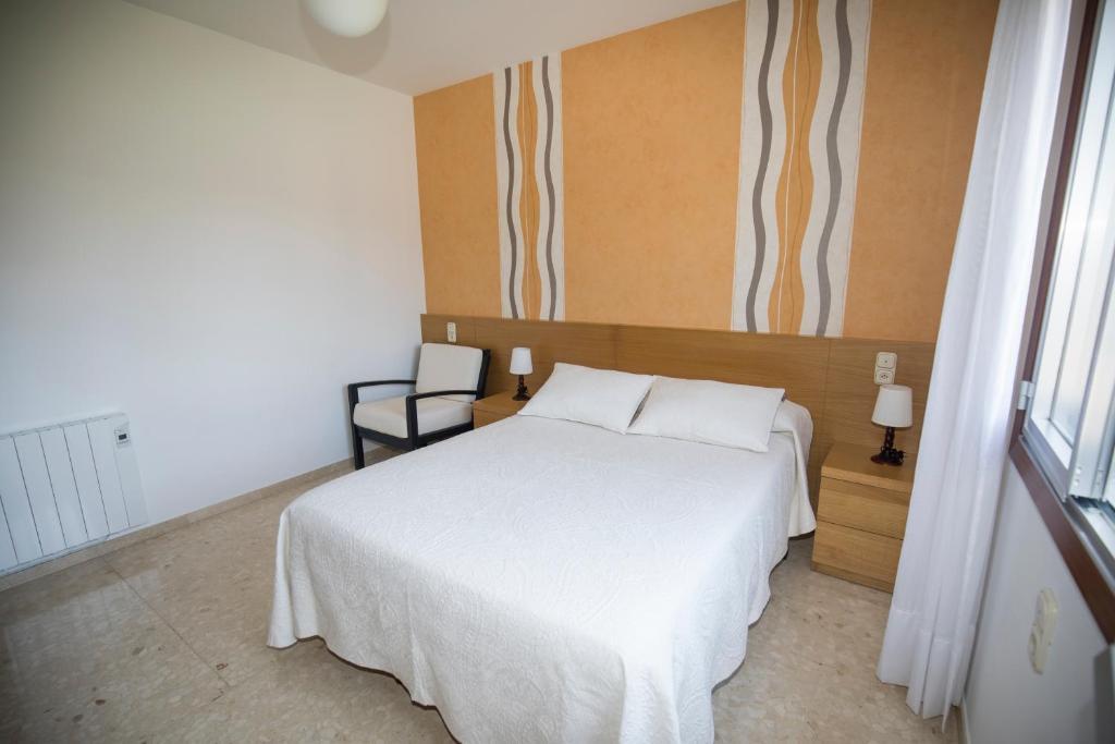 Ένα ή περισσότερα κρεβάτια σε δωμάτιο στο Pensión Casa Alvarito