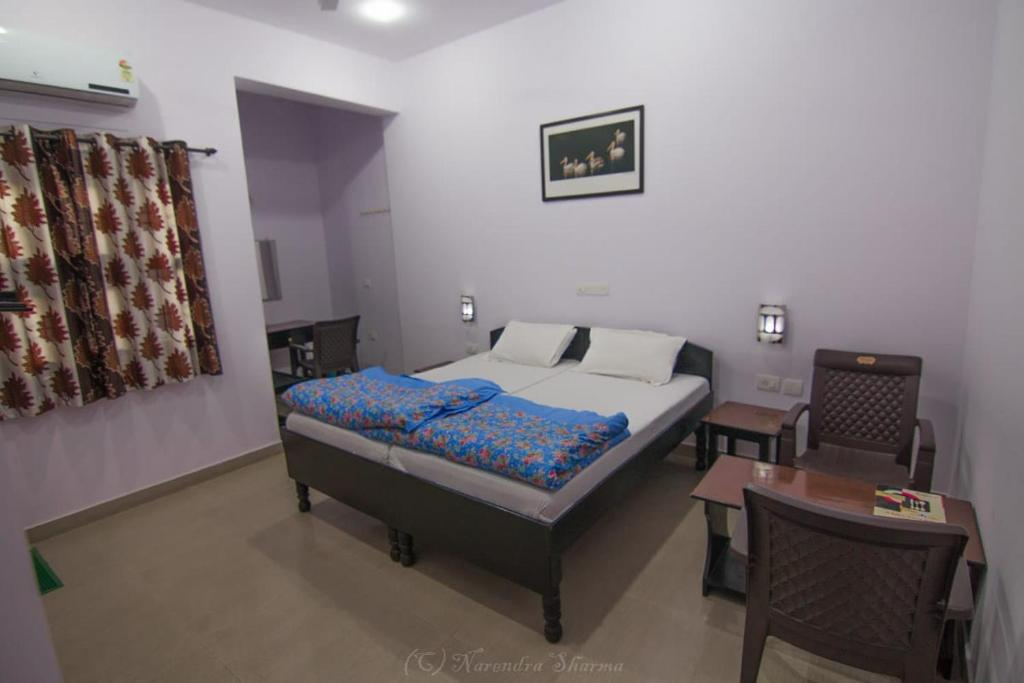 A bed or beds in a room at Sanctuary Tourist Lodge