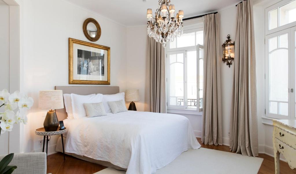 Uma cama ou camas num quarto em Grand House - Relais & Chateaux
