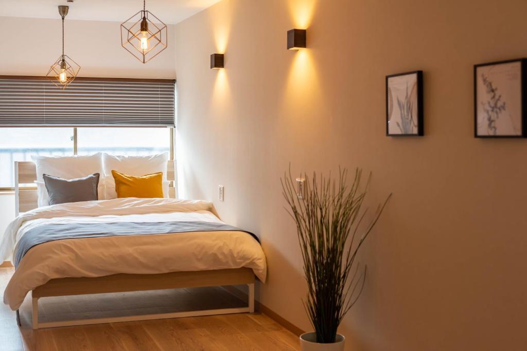 Bijou Suites Saudadeにあるベッド