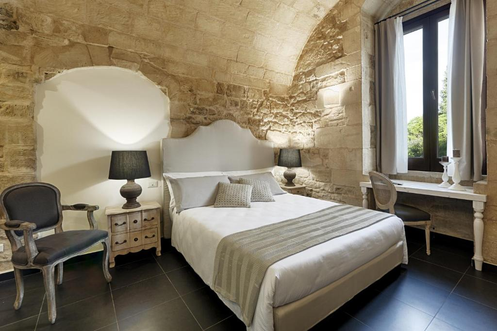 A bed or beds in a room at Itria Palace