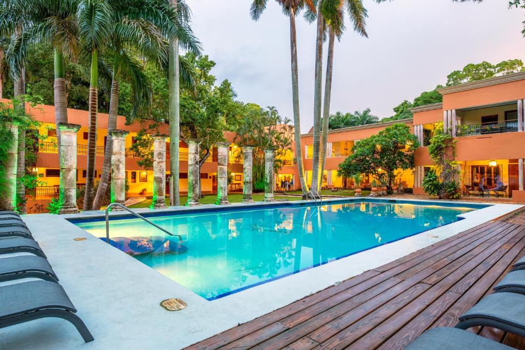 The swimming pool at or near Hacienda Uxmal Plantation & Museum