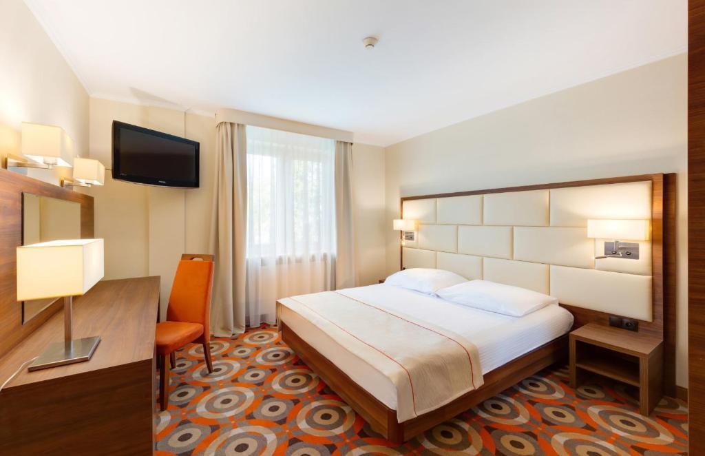 Łóżko lub łóżka w pokoju w obiekcie Hotel Boss