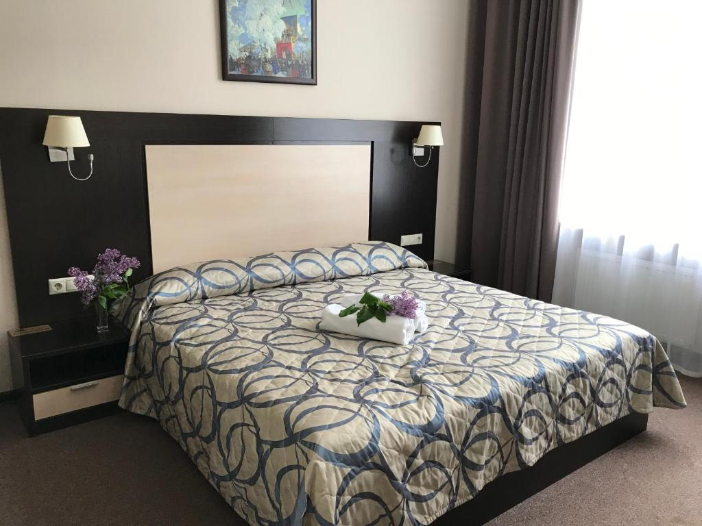 Кровать или кровати в номере Отель Воронцовский