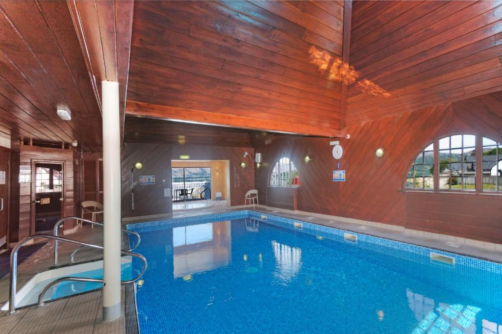 The swimming pool at or near Holly Tree Hotel and Swimming Pool