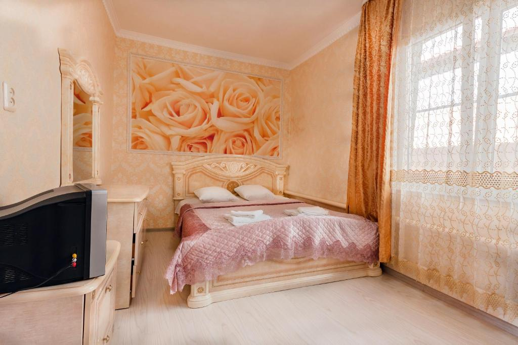 Кровать или кровати в номере Гостевой дом Аэлита