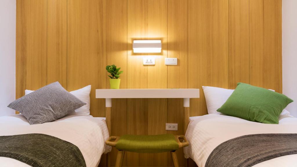 Un ou plusieurs lits dans un hébergement de l'établissement Meander Taipei Hostel - Ximending