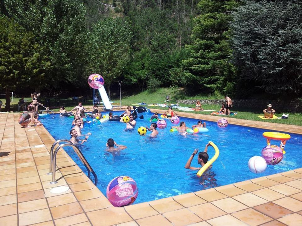 The swimming pool at or near Bungalows Pont d'Ardaix