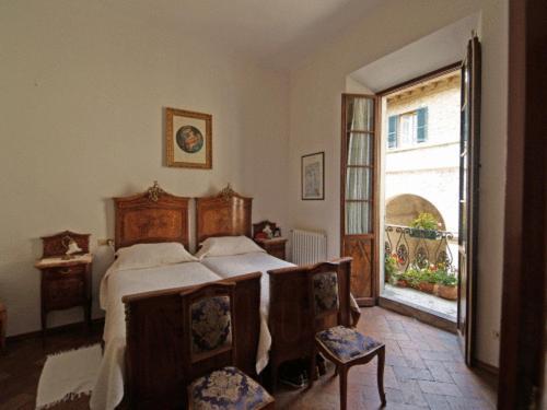 Een bed of bedden in een kamer bij Al Vecchio Convento