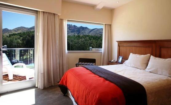 A bed or beds in a room at El Mirador Complejo Turístico