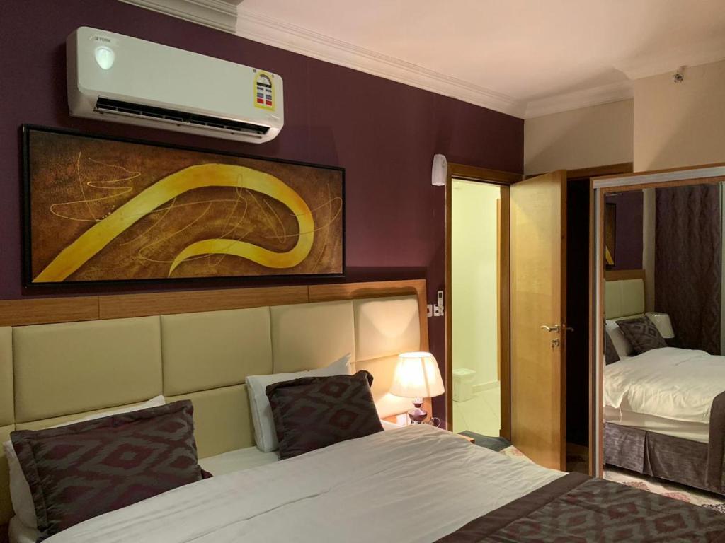Cama ou camas em um quarto em Altelal Apartment