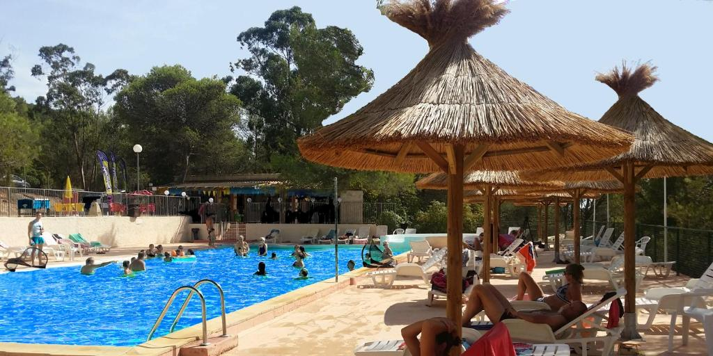 The swimming pool at or near Les Bois de Mont-Redon