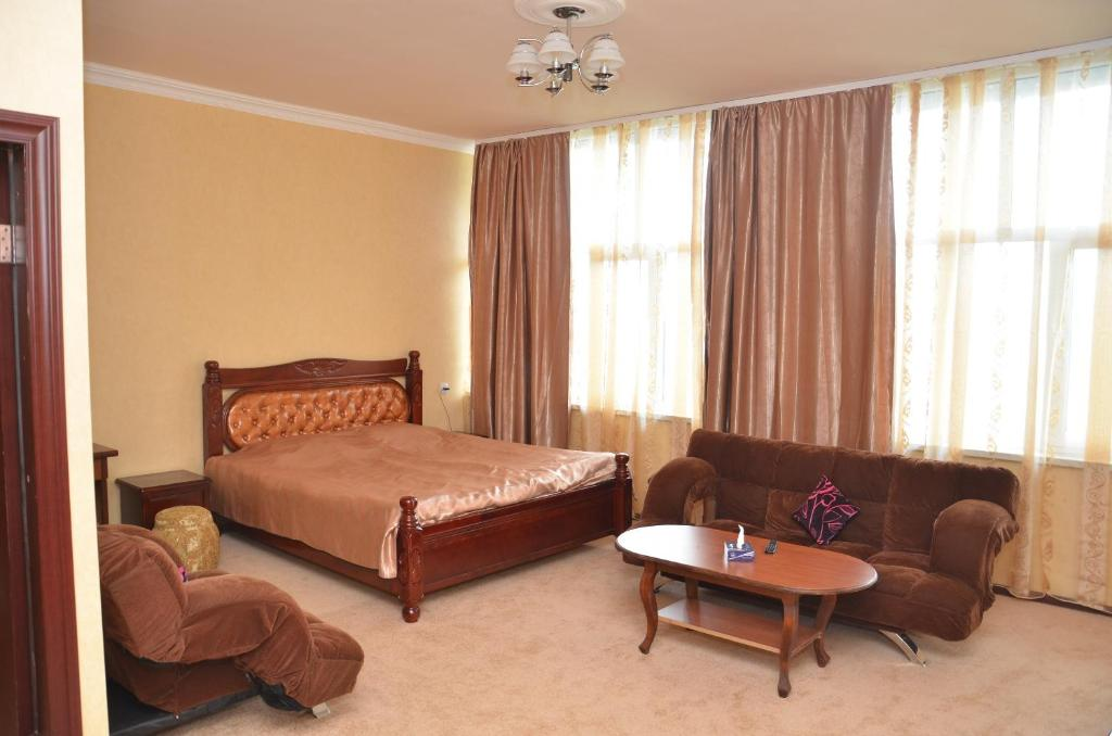 A bed or beds in a room at Vanadzor Armenia Health Resort & Hotel