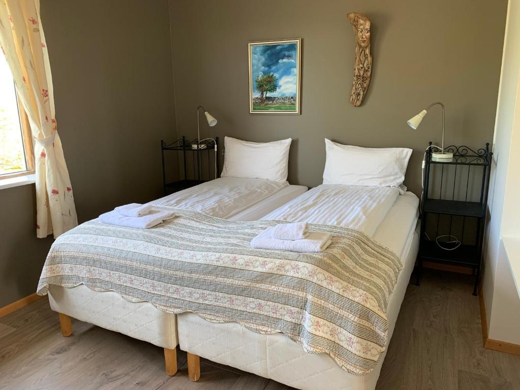 Un ou plusieurs lits dans un hébergement de l'établissement Hestheimar
