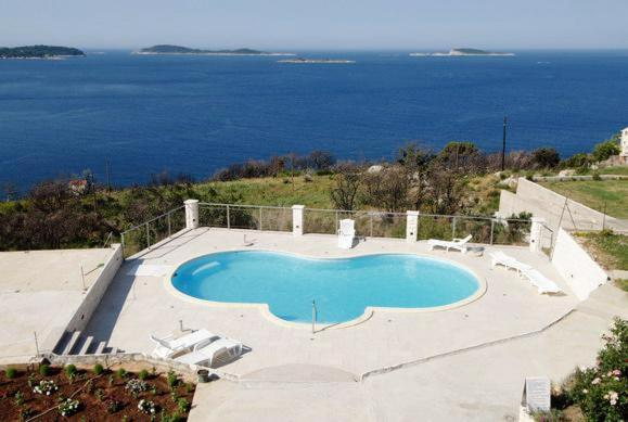 A view of the pool at Apartments with a swimming pool Soline, Dubrovnik - 4762 or nearby