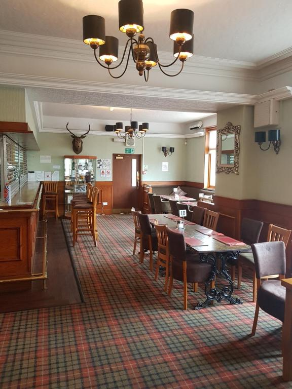 A restaurant or other place to eat at The Station Hotel