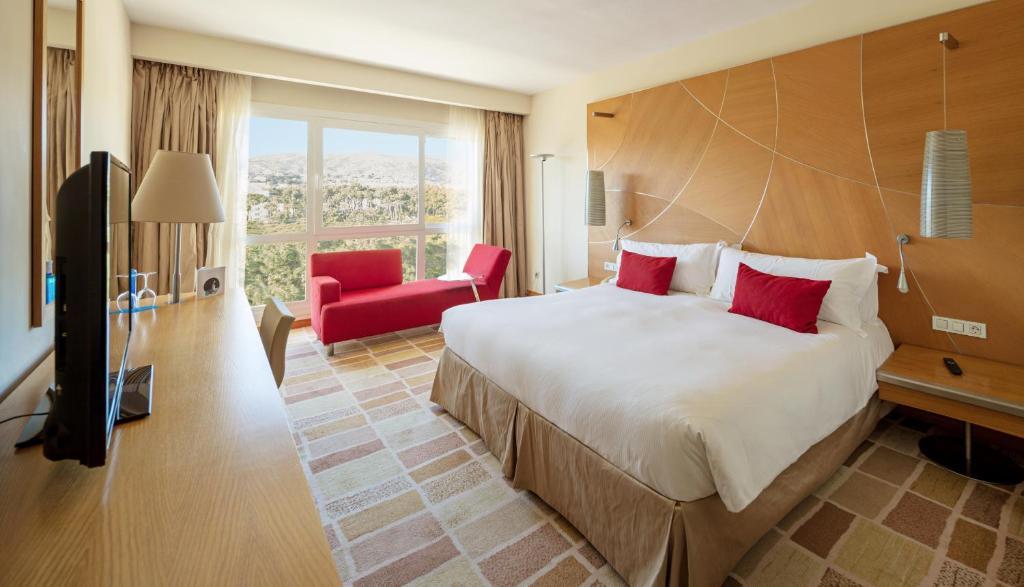 Säng eller sängar i ett rum på Don Carlos Resort & Spa