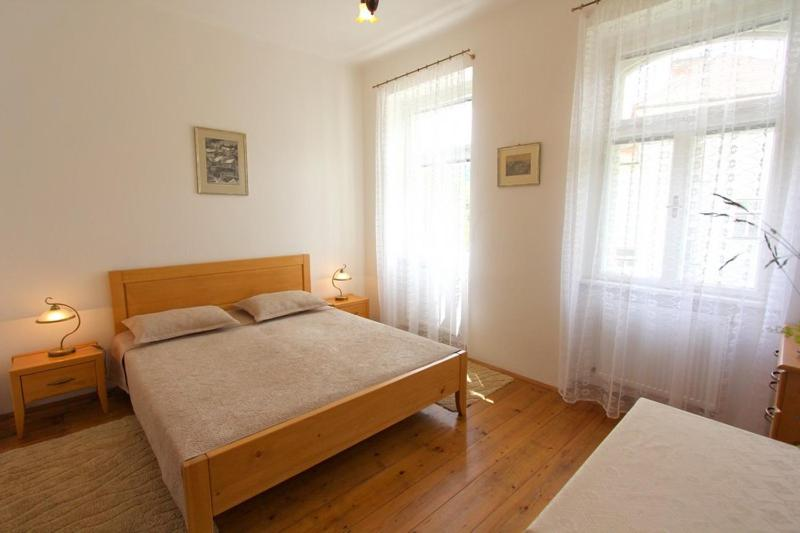A bed or beds in a room at Penzion Jelen Vranov nad Dyjí
