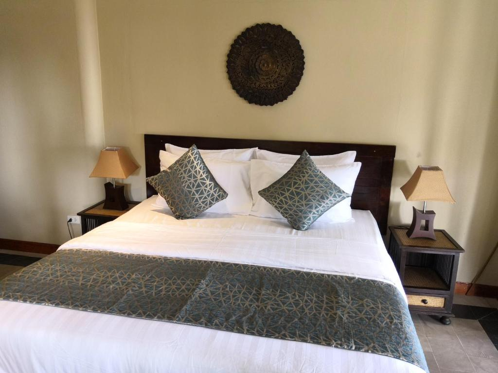 A bed or beds in a room at Beyond The Blue Horizon Boutique Bungalows