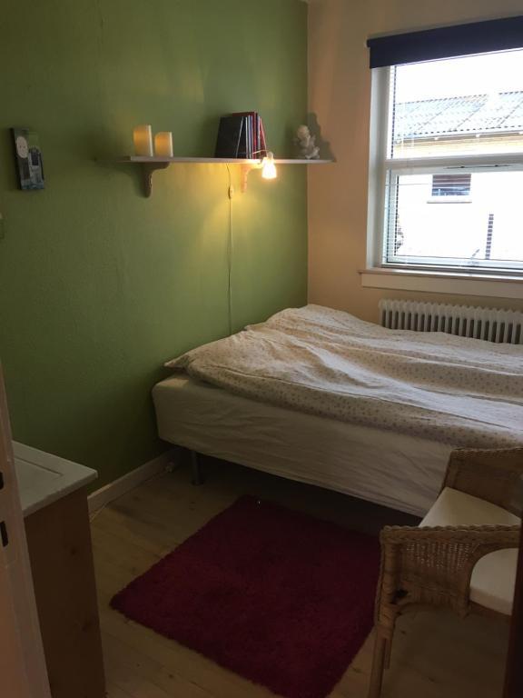 En eller flere senge i et værelse på Landet B&B