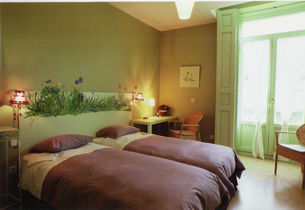 A bed or beds in a room at Hostal Fornos