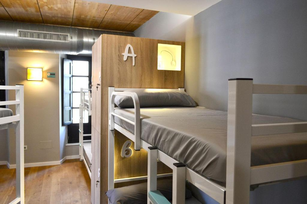 A bed or beds in a room at Albergue Alda Pilgrim León