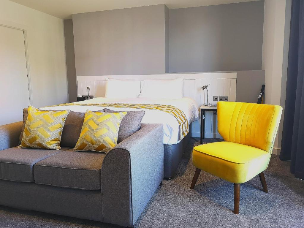 A bed or beds in a room at Mode Hotel Lytham