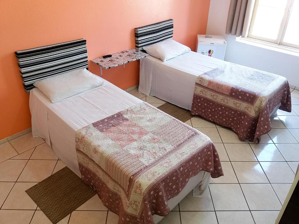 A bed or beds in a room at Hotel Record