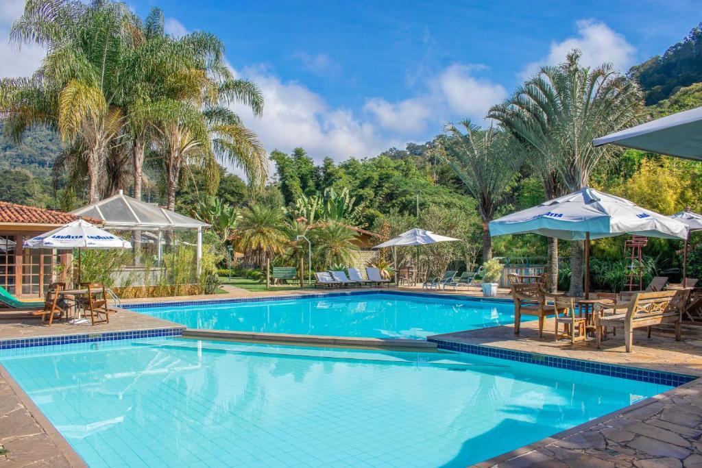 The swimming pool at or close to Bomtempo Hotel Esporte & Lazer