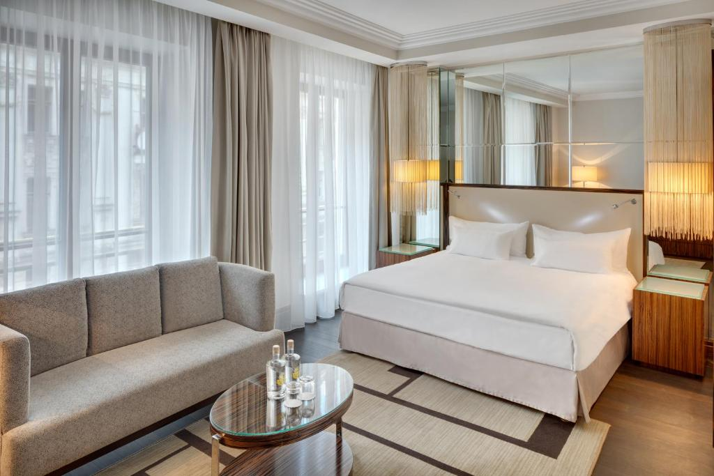 A bed or beds in a room at Alcron Hotel Prague