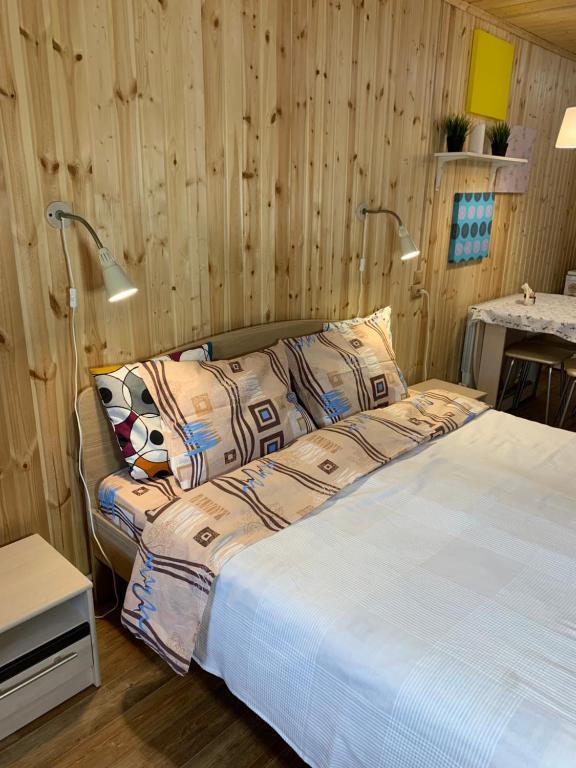 Кровать или кровати в номере Guest House Usadba