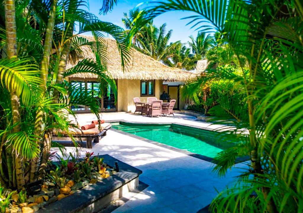 The swimming pool at or near Te Manava Luxury Villas & Spa