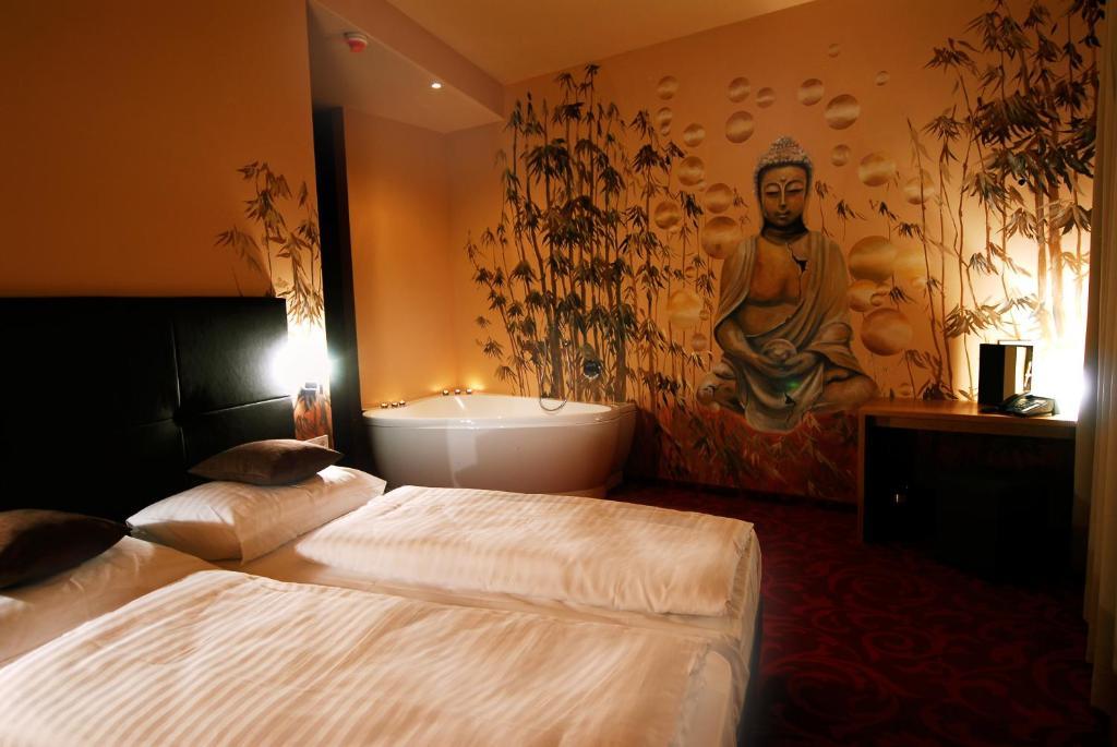Ein Bett oder Betten in einem Zimmer der Unterkunft Kuschelhotel Zeman