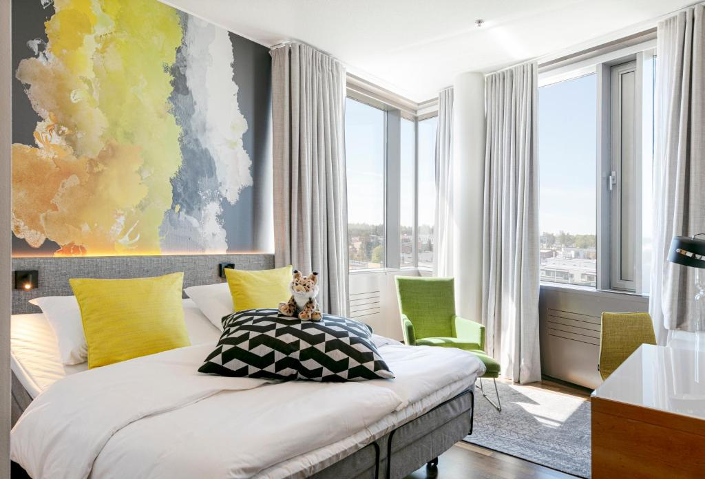 A bed or beds in a room at GLO Hotel Sello