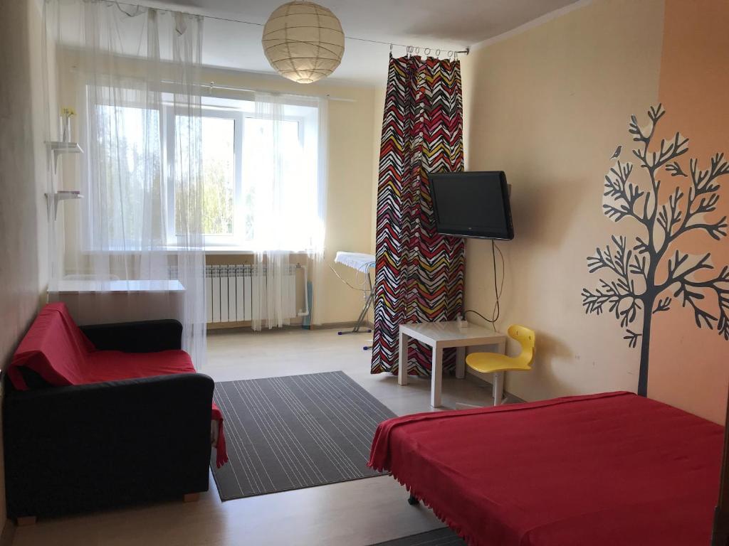 Телевизор и/или развлекательный центр в Апартаменты на Ленина